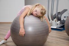 Girl with gym ball Stock Photo