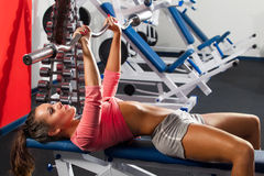 Girl in gym Bar Bench Press stock image