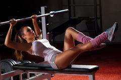 Girl in gym Bar Bench Press Stock Images