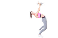 Girl at gym bending back holding weight. Isolated on white background with copy text space Royalty Free Stock Photos