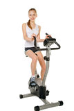 Girl with gym bicycle Stock Photos
