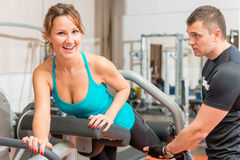 Girl at the gym doing exercises Stock Image