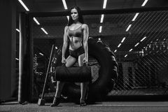 Black and white photography. Young beautiful girl athlete bodybu Stock Images