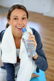 Girl in gym drinking water Stock Photo
