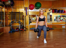Girl in gym with dumbbells Stock Photography