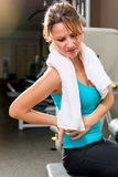Girl in the gym holding  of a sick back. Girl in the gym holding a hand of a sick back Stock Images