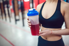 Girl in the gym holding a sports nutrition Stock Photo
