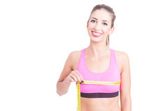 Girl at gym measuring her bust line Stock Photo
