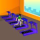 The girl is in the gym and runs along the treadmill. The girl in the topic is engaged in sports in the modern fitness hall. She purposefully runs along the Stock Photos