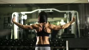Girl in the gym. Weight training. Work on the muscles of the back. bodybuilding stock video