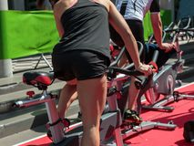 Girl at Gym: Workout with Spinning Bike.  Stock Photography