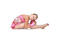 Girl gymnast with ball. Little girl gymnast posing with the ball, isolated on white Royalty Free Stock Image