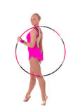 Girl gymnast in a costume with a hoop. Beautiful slim girl gymnast in a costume with a hoop over white background royalty free stock photos