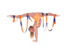 Girl gymnast with a gymnastic ribbon. Over white background stock photography