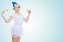 The girl gymnast in the hood Santa Claus. Royalty Free Stock Photos