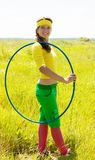 Girl-gymnast with hula hoop Royalty Free Stock Photo