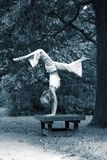 Girl gymnast in park. The girl in park Royalty Free Stock Photography
