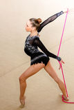Girl gymnast performs with a rope at the competition Stock Images
