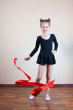 Girl gymnast with red ribbon Royalty Free Stock Image
