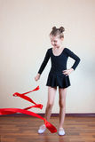 Girl gymnast with red ribbon Stock Photos