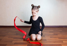 Girl gymnast with red ribbon Stock Photography