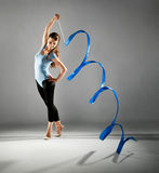 Girl gymnast with a ribbon Stock Photography