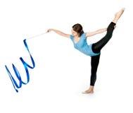 Girl gymnast with a ribbon Stock Photos