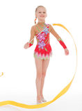 Girl gymnast with ribbon. Royalty Free Stock Images