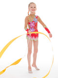 Girl gymnast with ribbon. Royalty Free Stock Photos