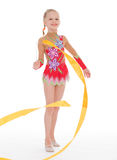 Girl gymnast with ribbon. Royalty Free Stock Image