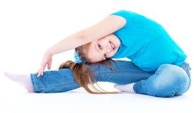 Girl gymnast on a white background Stock Photos