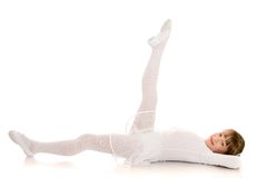 Girl gymnast in white swimsuit does sports Royalty Free Stock Photography