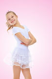 Girl gymnast in a white tracksuit. Royalty Free Stock Images