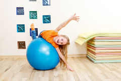 Girl on a gymnastic ball Royalty Free Stock Image