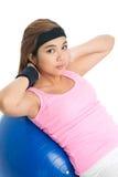 Girl on gymnastic ball Royalty Free Stock Image