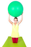 Girl with gymnastic ball Stock Images