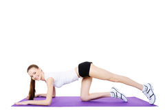 Girl on the gymnastic carpet Royalty Free Stock Images