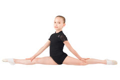 Girl gymnasts, sitting on the splits Royalty Free Stock Photo