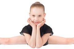 Girl gymnasts, sitting on the splits Stock Photos