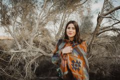 Girl in gypsy look in desert nature royalty free stock image