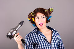 Girl with hair blower Stock Photos