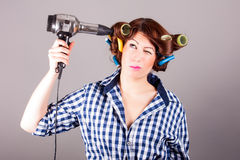 Girl with hair blower Royalty Free Stock Photo
