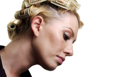 The girl about hair curlers Stock Images