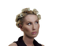 The girl about hair curlers Royalty Free Stock Image