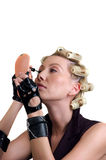 The girl about hair curlers Royalty Free Stock Photography