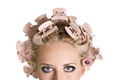 Girl with hair curlers Stock Image