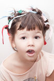 The girl with hair curlers on her head stock photos