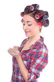 Girl with hair curlers rollers. Funny beauty woman with hair rollers looking Royalty Free Stock Photo