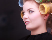 Girl hair curlers rollers by hairdresser in salon Royalty Free Stock Image