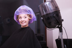 Girl hair curlers rollers hairdresser salon Royalty Free Stock Images